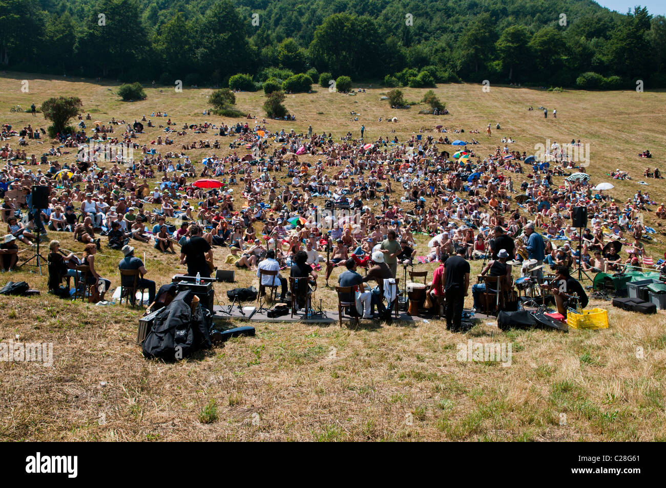 Audience gathering on a mountain for the classical music concert I Suoni delle Dolomiti, Malga Fratte, Plateau Vezzena, - Stock Image