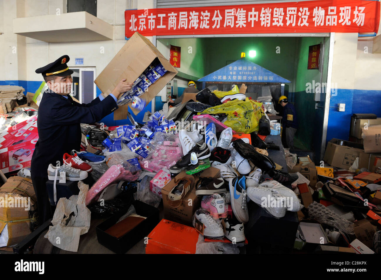 FAKE GOODS SEIZED IN CRACKDOWN Thousands of fake phones and footwear pile  up at a warehouse e32cfb55abdd