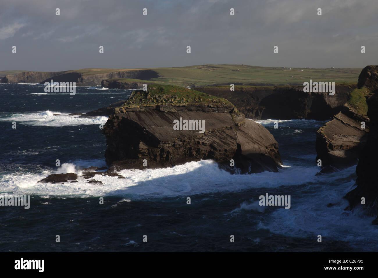 ireland county  clare, atlantic sea waves crashing onto irish landmass, beauty in nature, wild atlantic way, - Stock Image