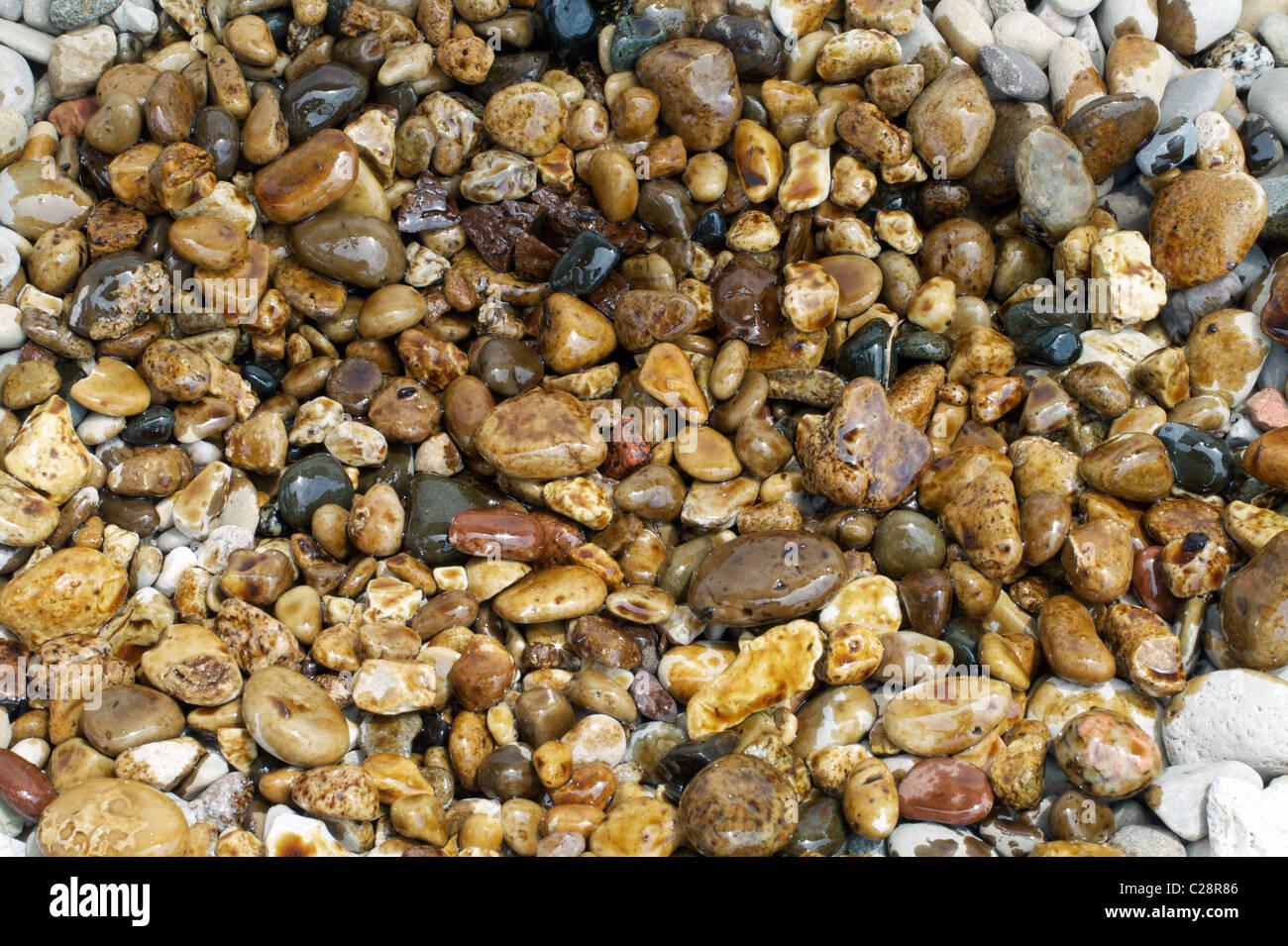 Oil spill on the rocks - Stock Image
