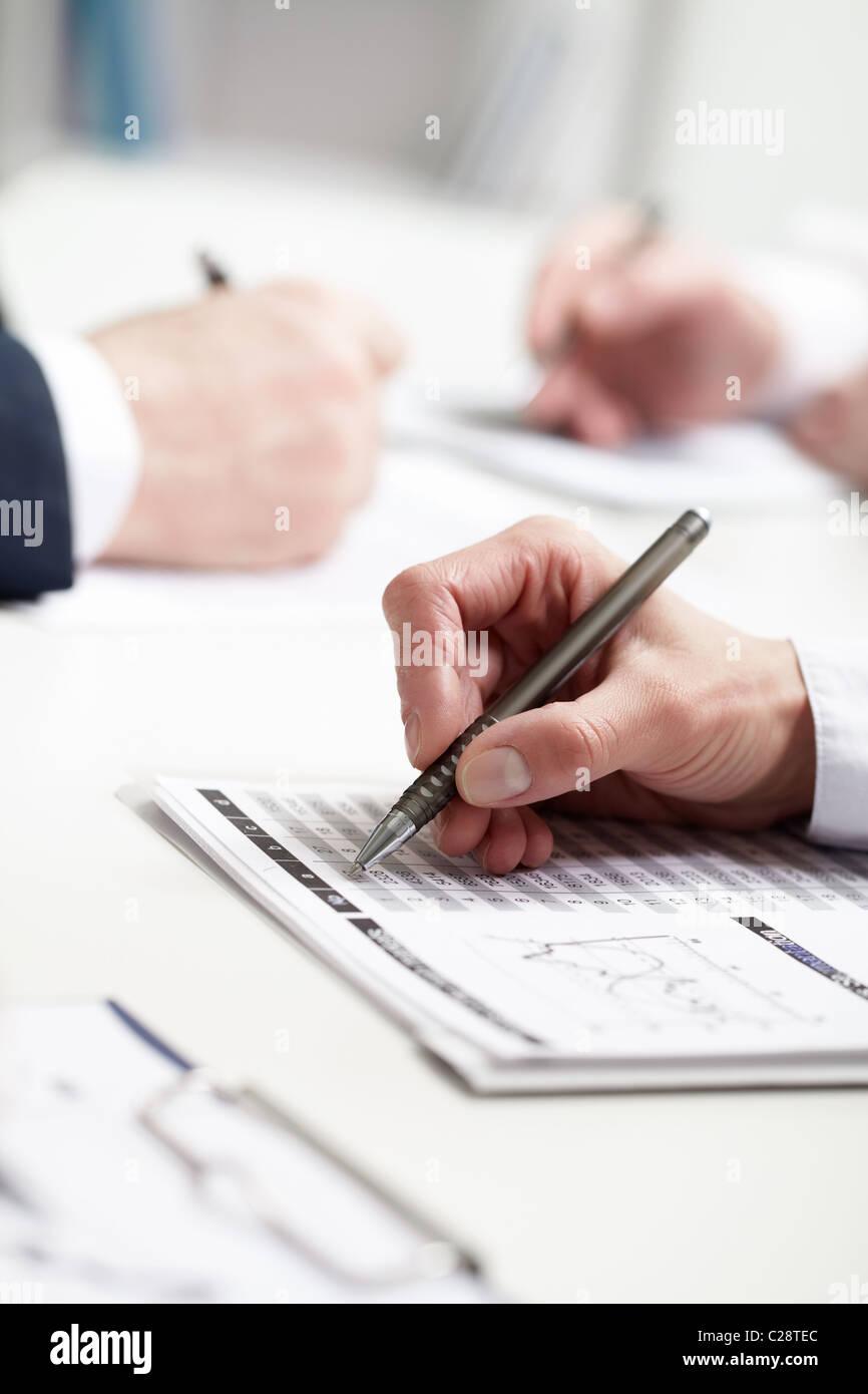 Image of businesswoman's hand writing - Stock Image