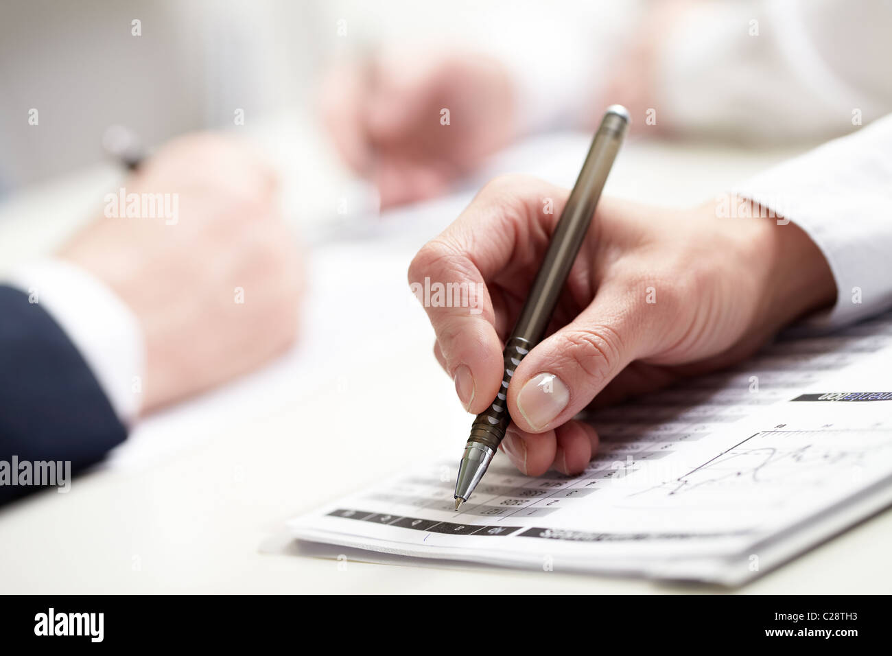close-up of businesswoman's hand writing - Stock Image