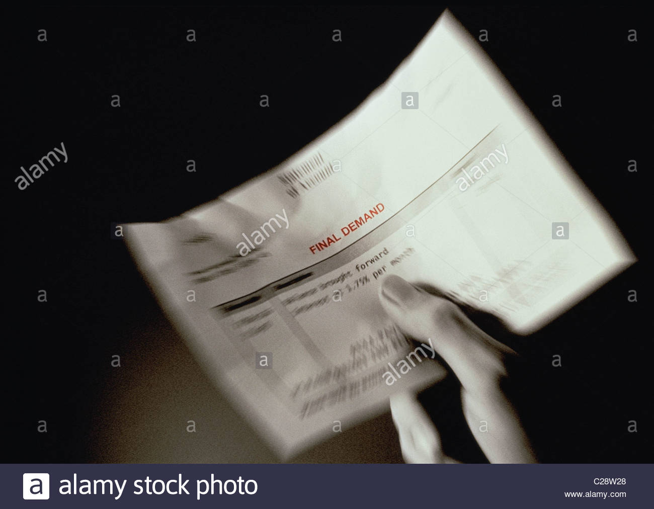 Hand holding a final demand  statement - Stock Image