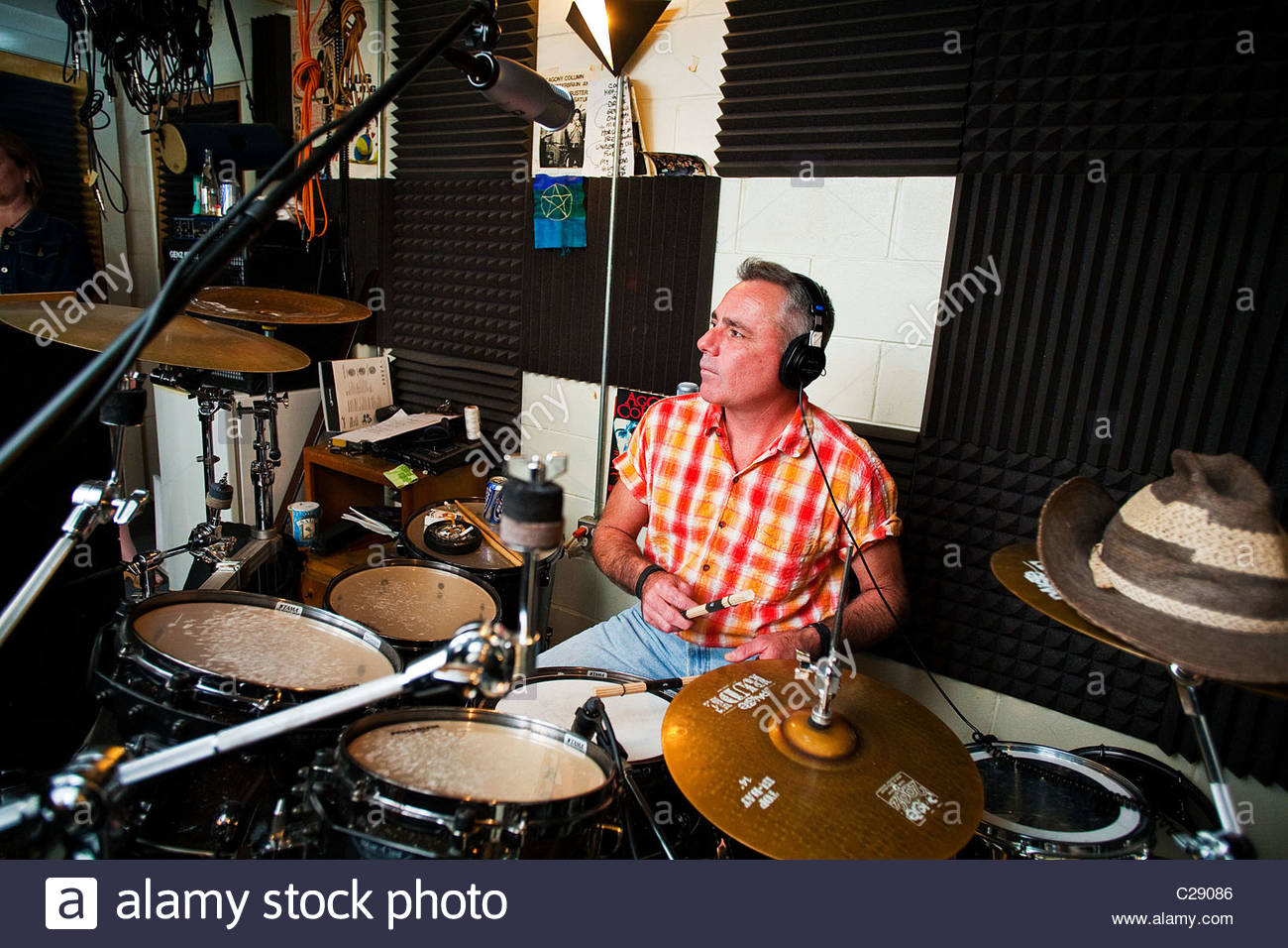A drummer plays drums on 'Moon Pies and Rib Eyes'. - Stock Image
