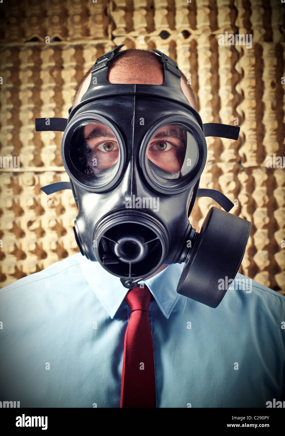 portrait of businessman wearing classic gas mask - Stock Image