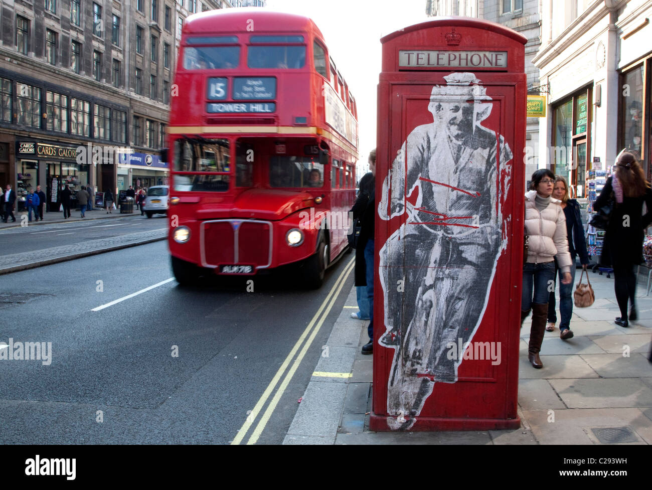 Graphic of Albert Einstein on bicycle on telephone box in Central London - Stock Image