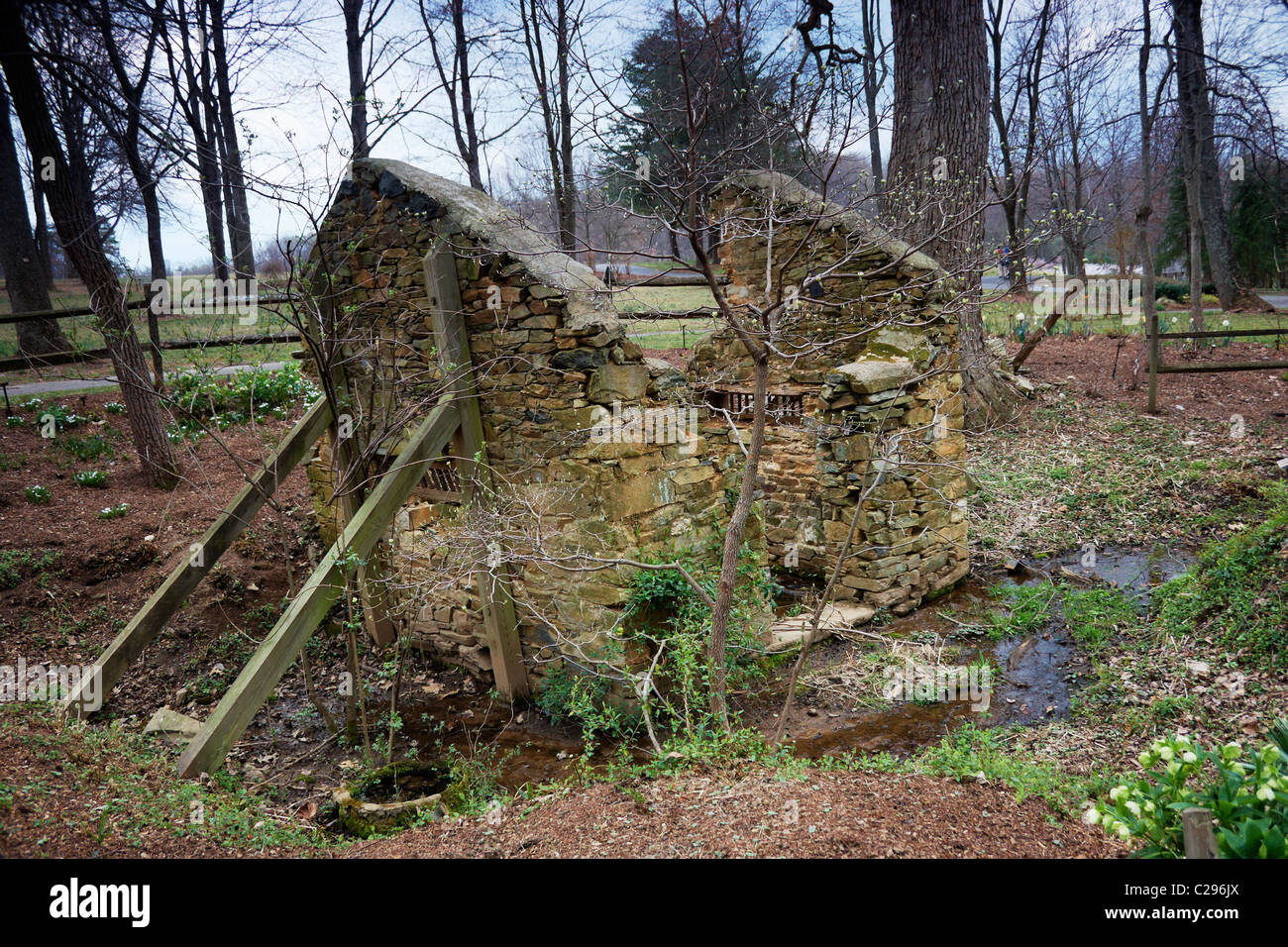 The crumbling remnants of an old springhouse on the grounds of Stock ...