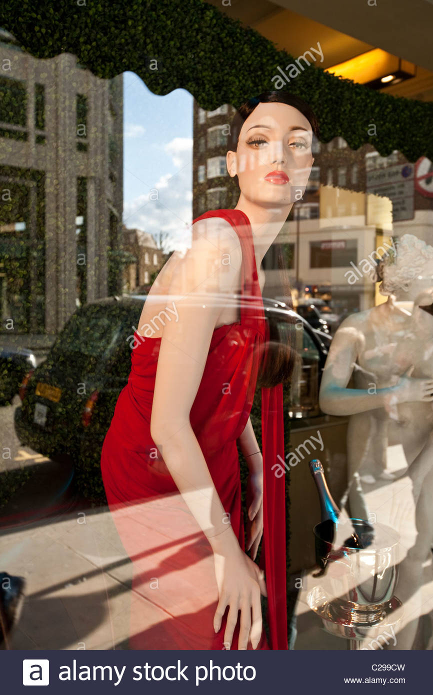 Reflection of a taxi in Harrods Department store window. - Stock Image