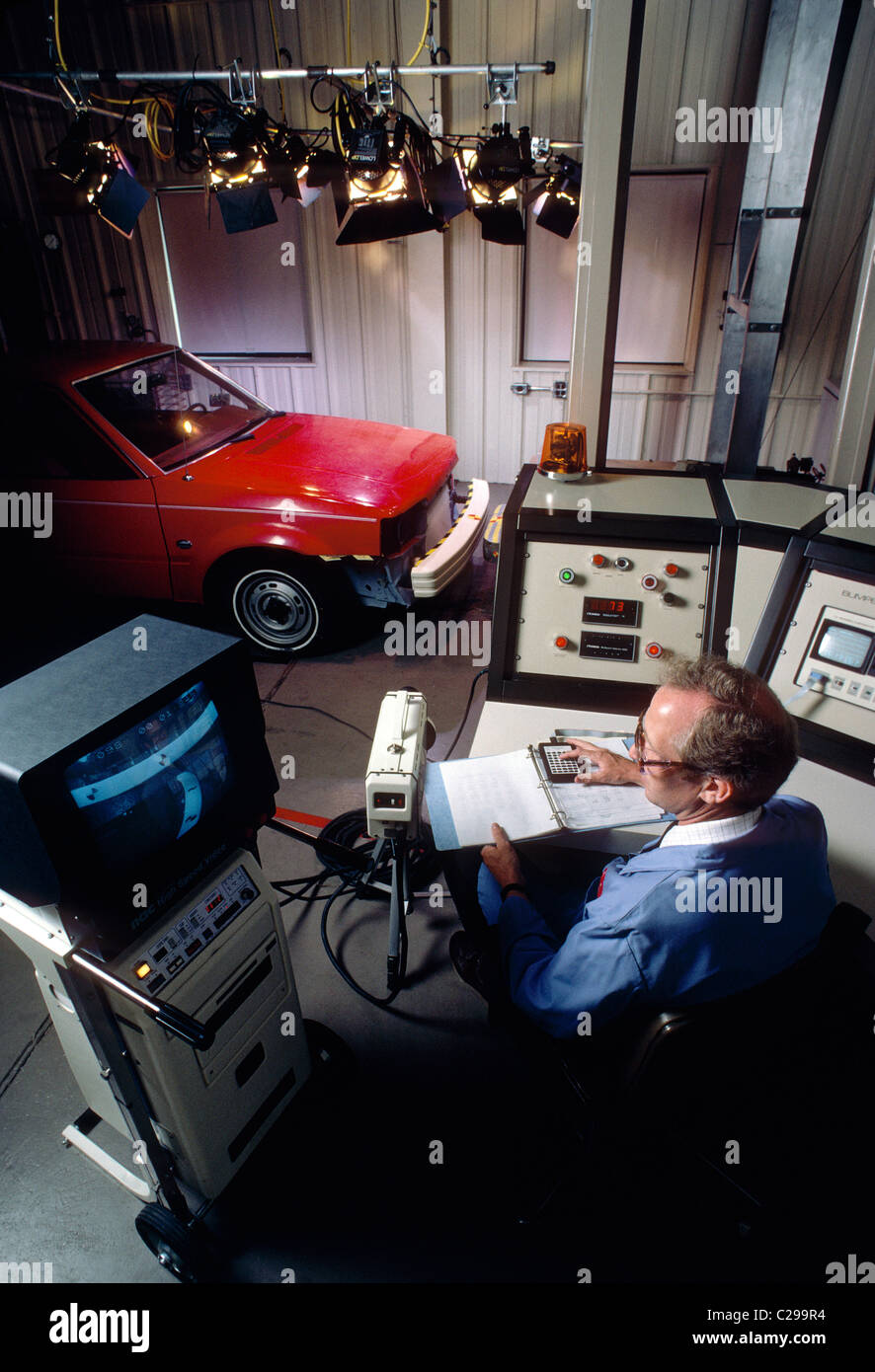 Male engineer performing an automobile bumper test in the laboratory of a chemical company Stock Photo