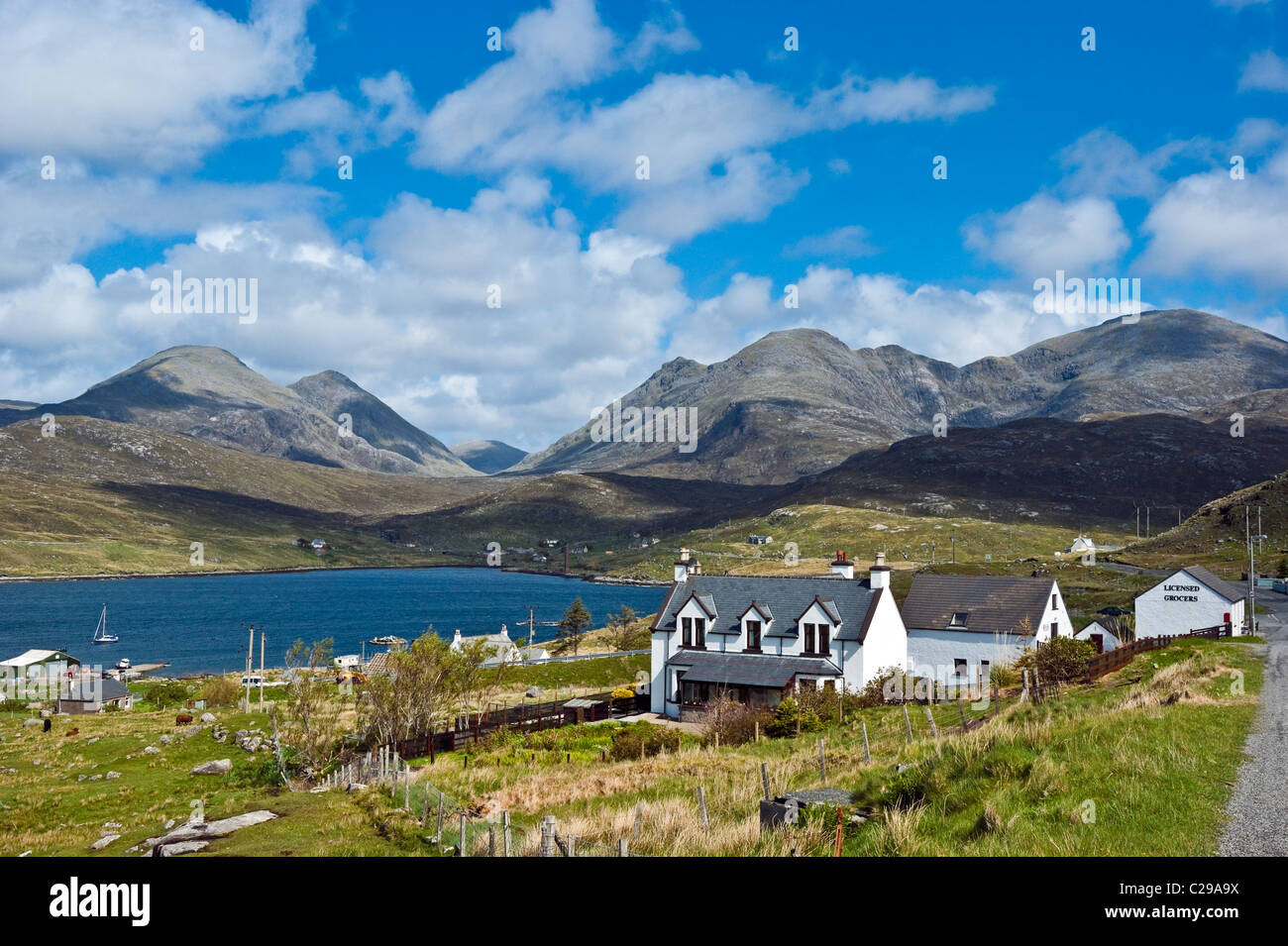Impressive North Harris mountains behind the small village of Aird Asaig on the A859 connecting Tarbert with Stornoway - Stock Image