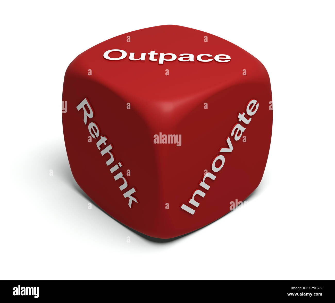 Red Dice with words Rethink, Innovate, Outpace on faces - Stock Image
