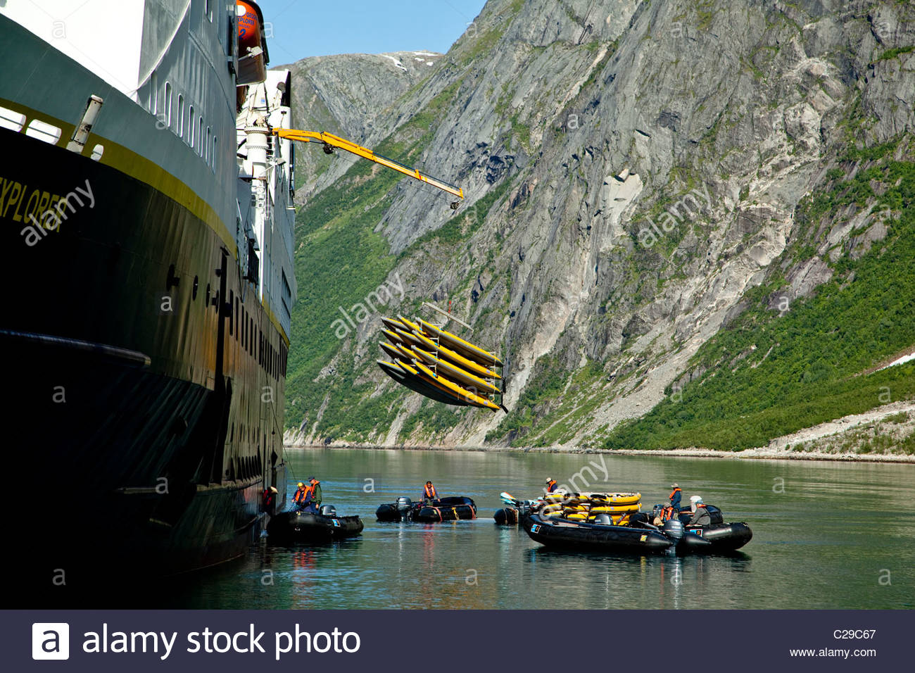 A stack of kayaks is lowered from National Geographic Explorer. - Stock Image