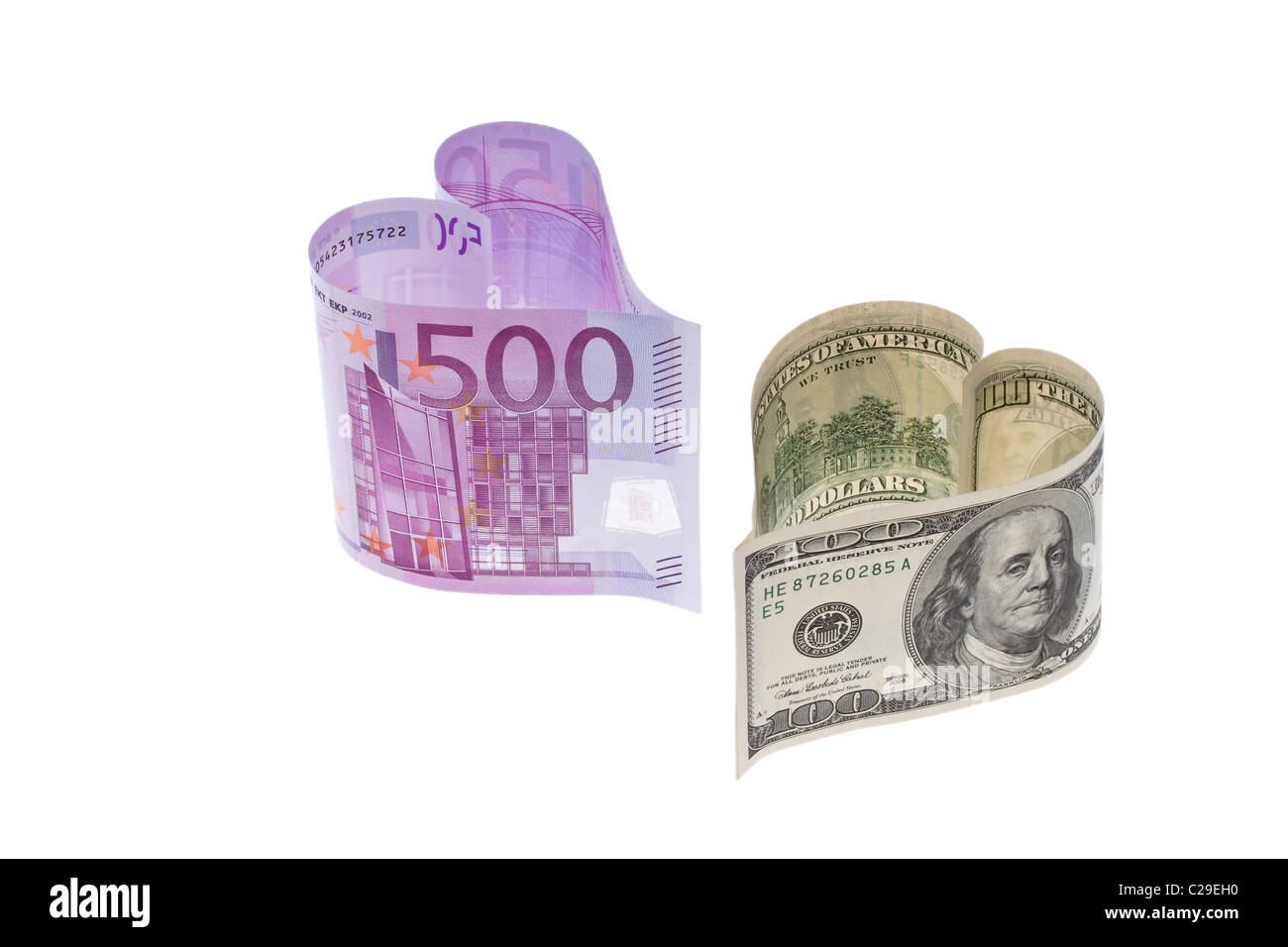 Euro banknotes and U.S. dollars. - Stock Image