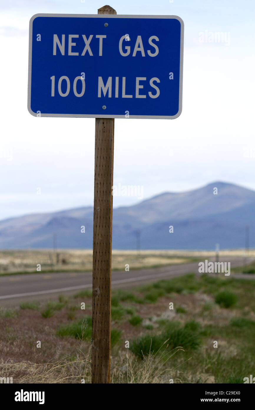 Next gas 100 miles road sign at the Oregon/Nevada border in McDermitt, USA. Stock Photo