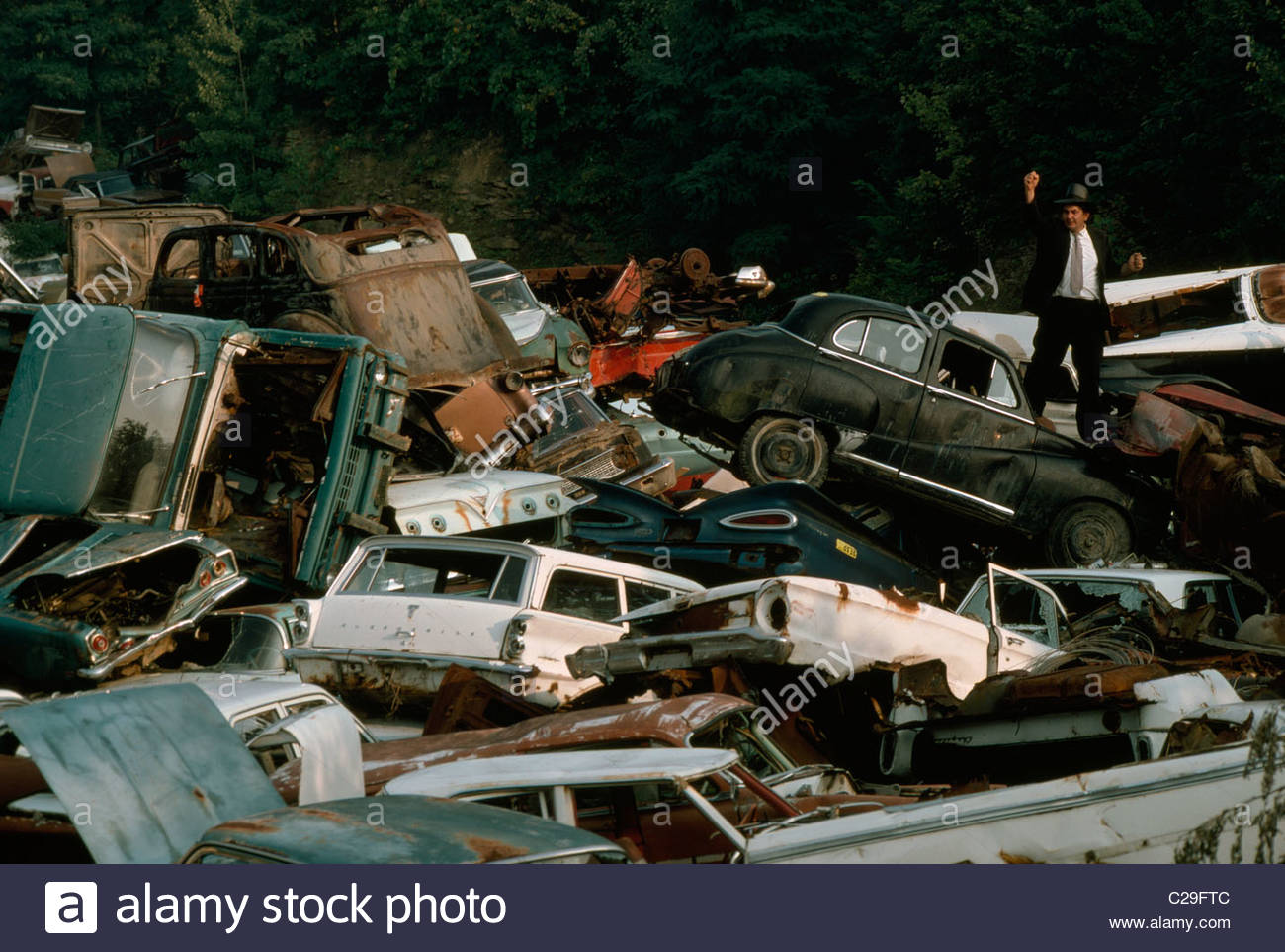 A car junkyard where cars are stored until they are crushed. - Stock Image