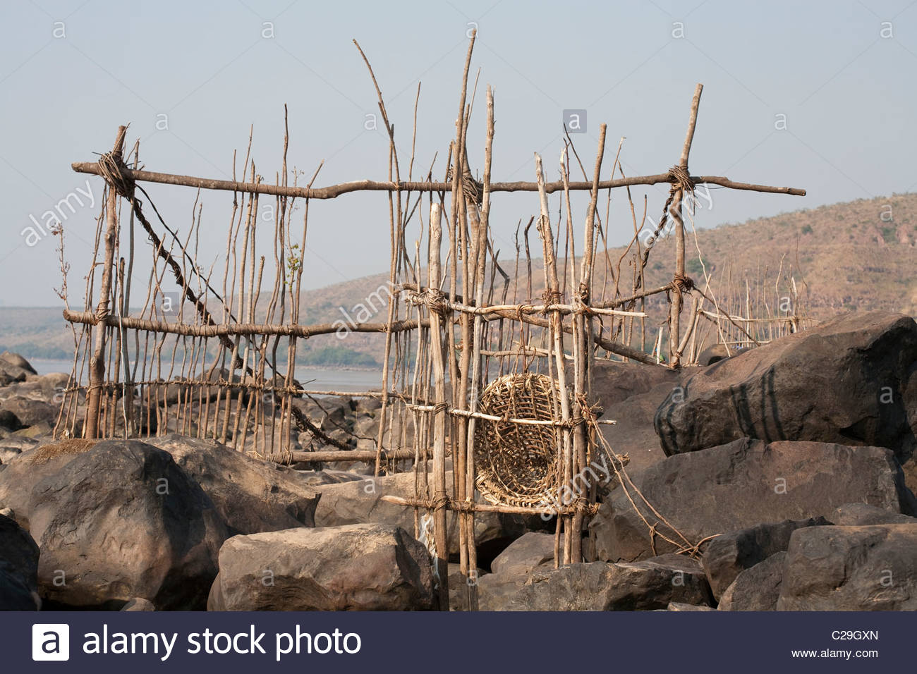 An elaborate system of fish traps exposed by low water. - Stock Image