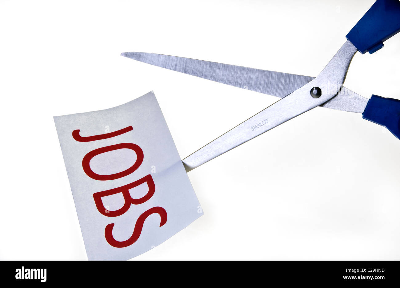 Job Cuts. Scissors cutting paper. - Stock Image