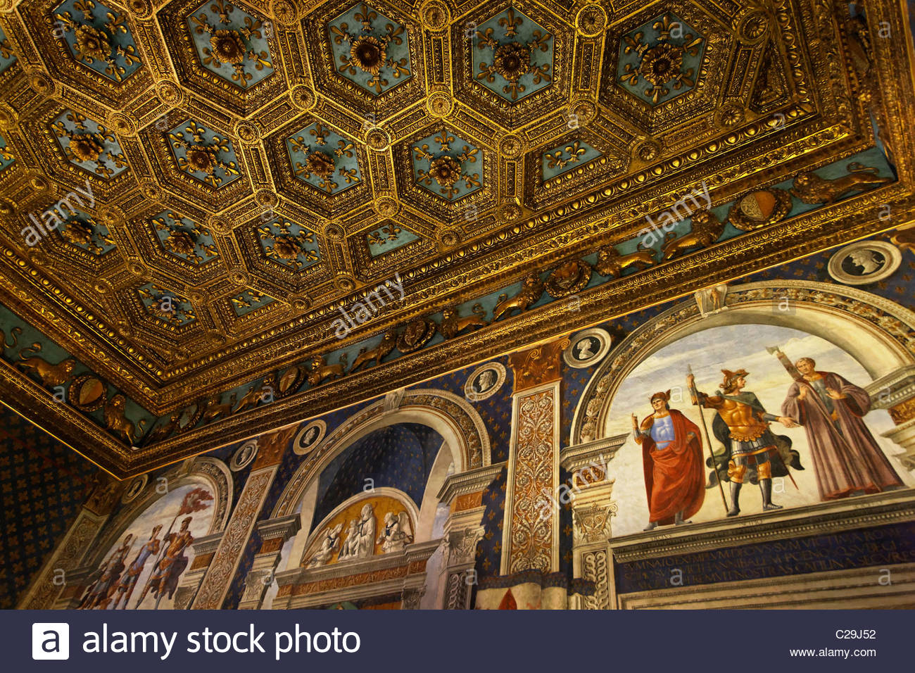 Ceiling panels of gold laminated fleur de lis in the Palazzo Vecchio. - Stock Image