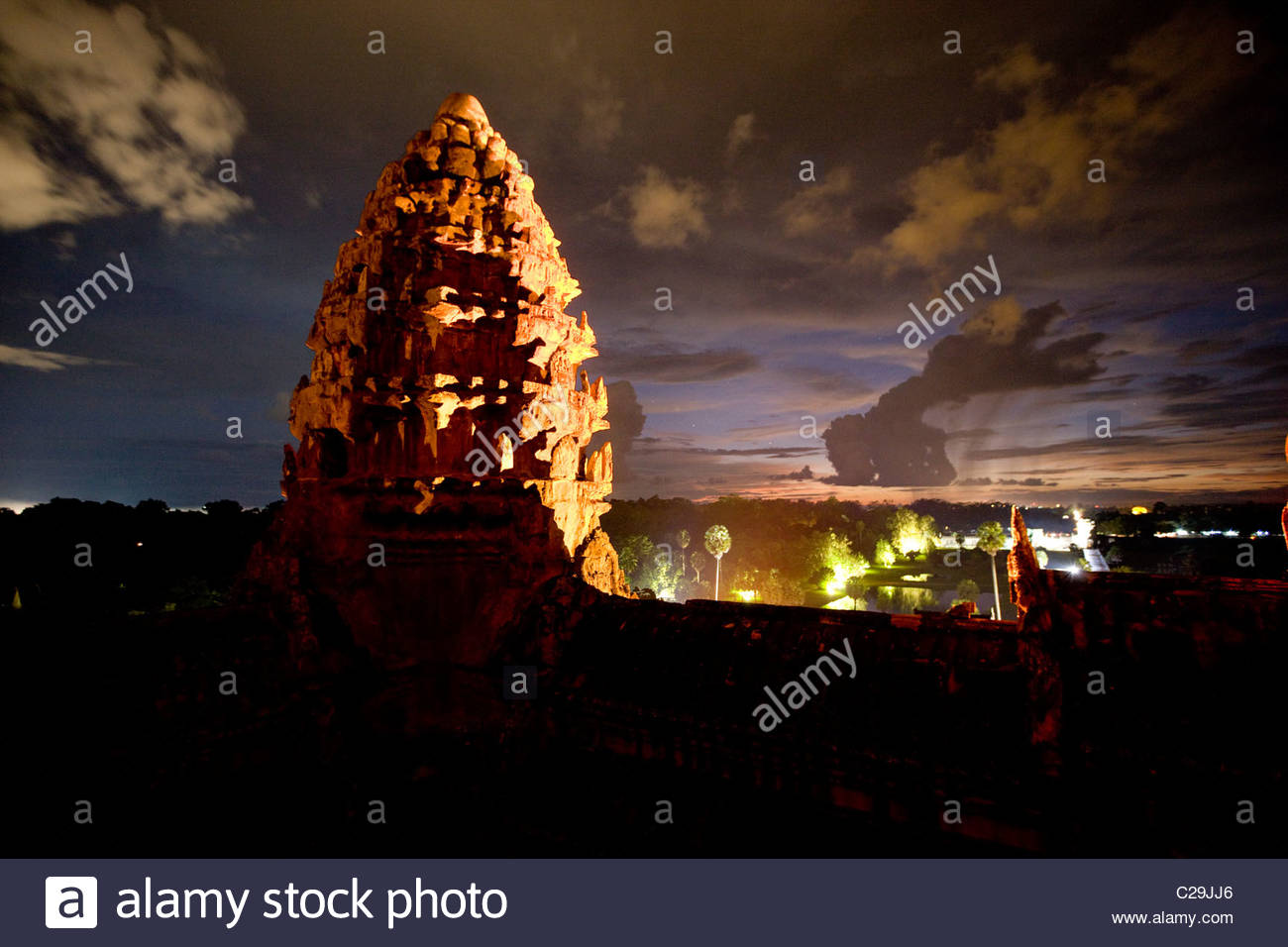 Illuminated at night, a lotus bud-shaped tower gleams at Angkor Wat. - Stock Image