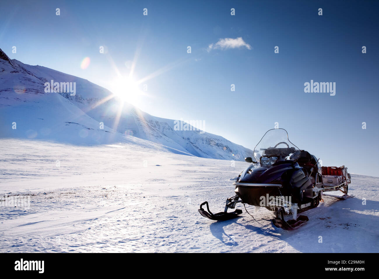 A snowmobile in a winter mountain landscape - Stock Image