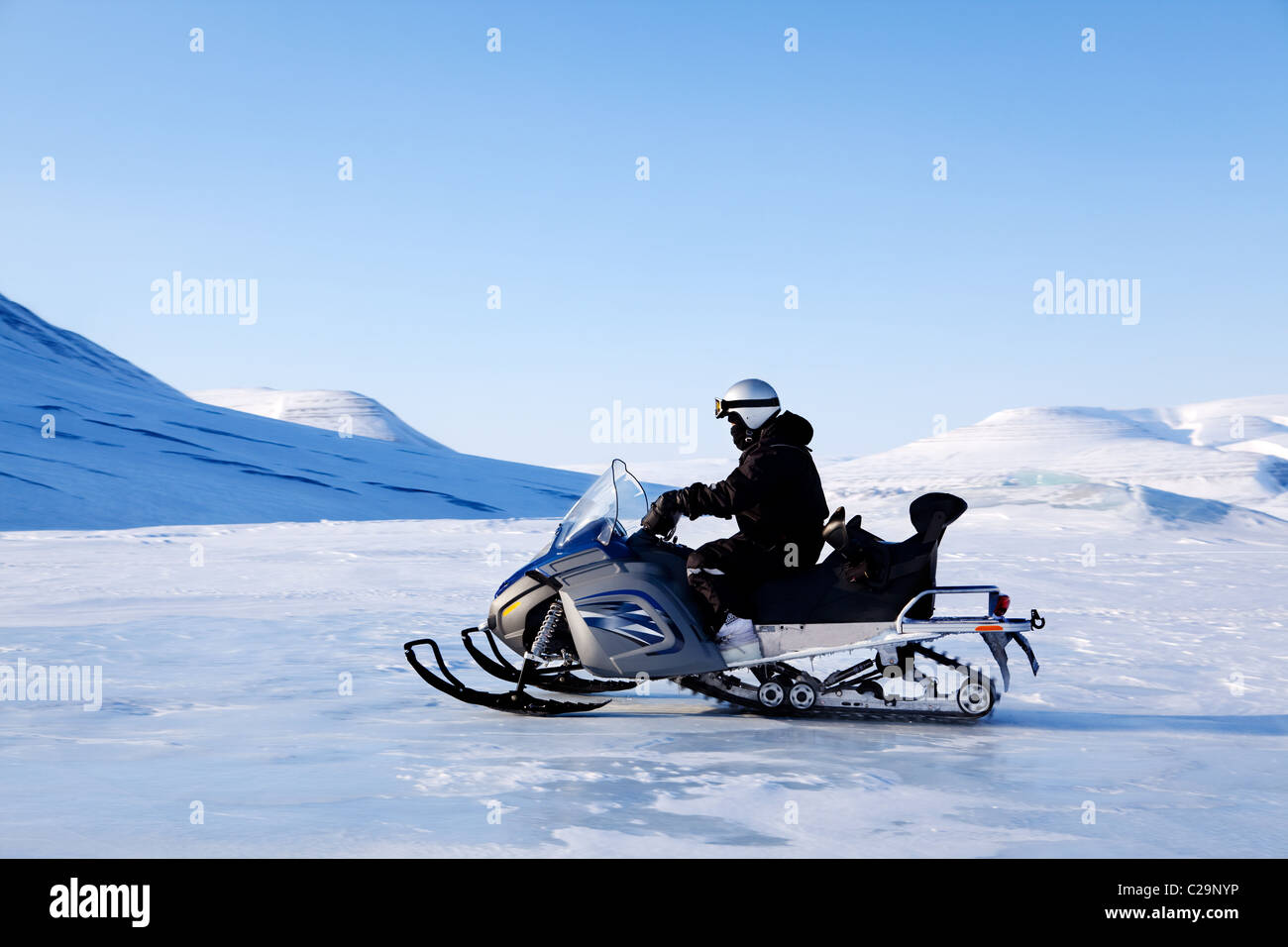 A snowmobile on a beautiful winter mountain landscape - Stock Image