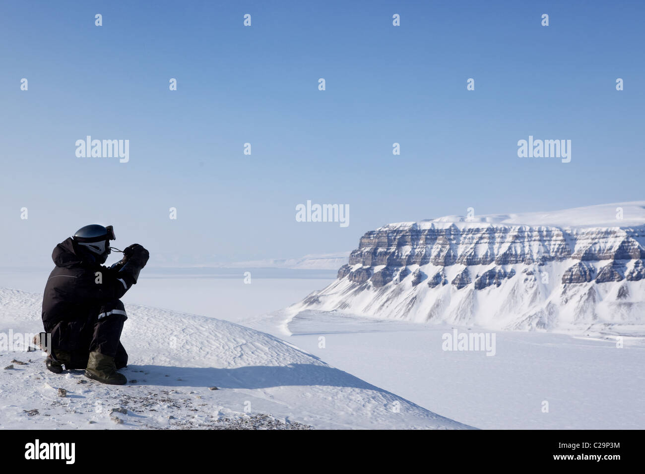 A winter wilderness adventure guide. Spitsbergen, Svalbard, Norway - Stock Image