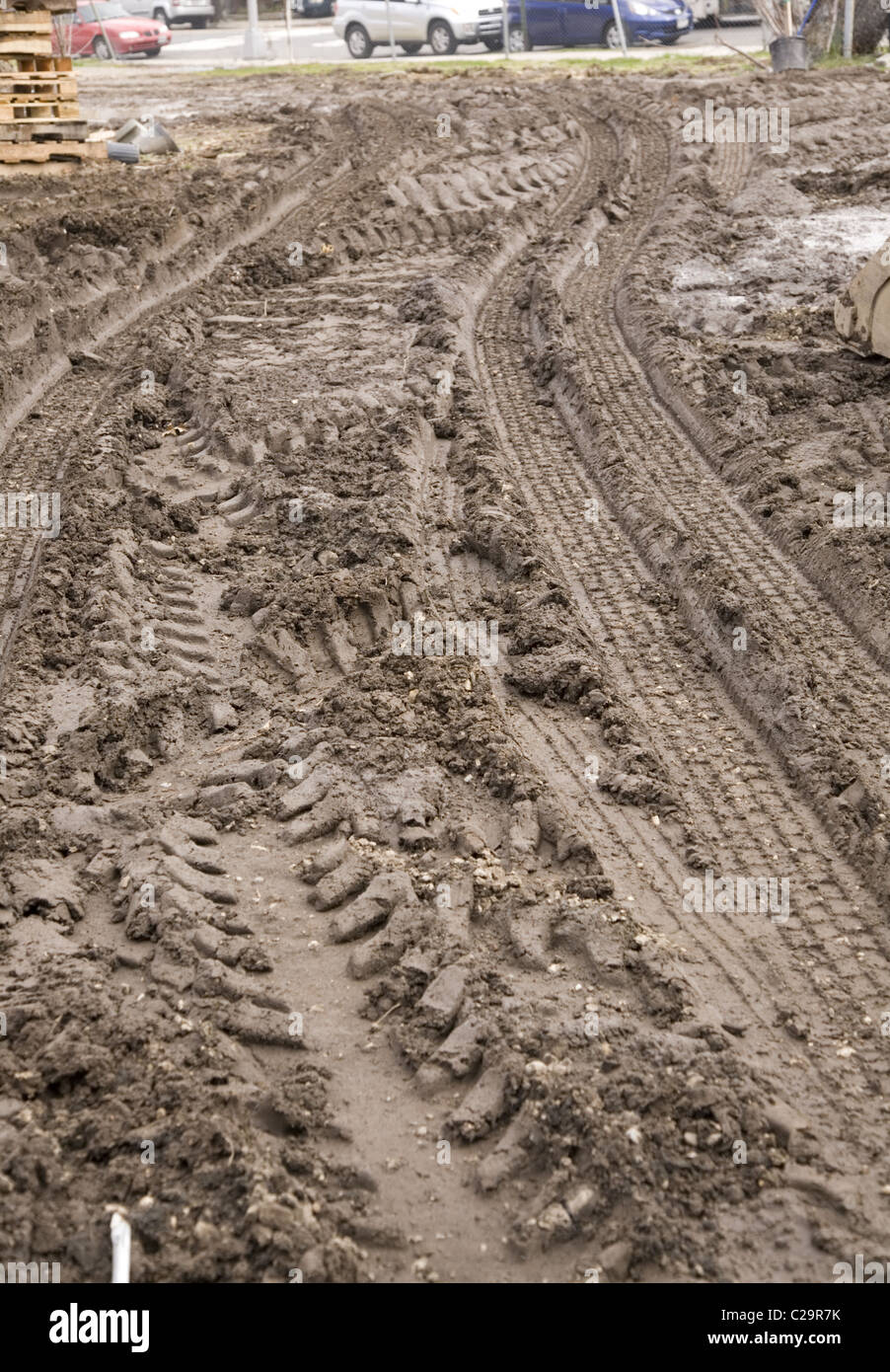 Tire tracks in the mud, storage lot, Brooklyn, NY. - Stock Image