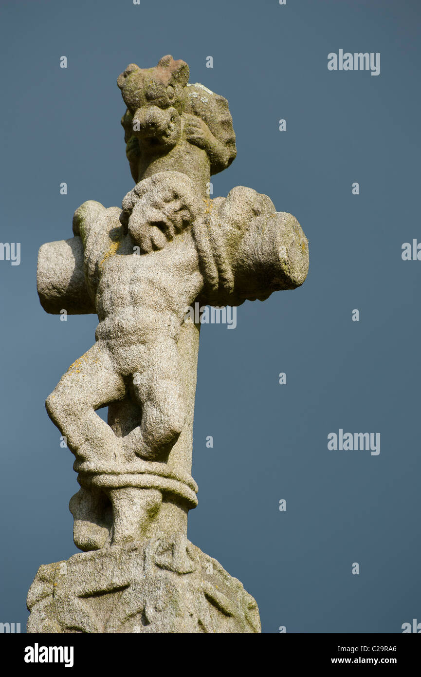 One thief, detail of  Guéhenno (56420) Calvary ,  Morbihan, Brittany, France, Europe. Build in 1550 by F.Guillonic - Stock Image