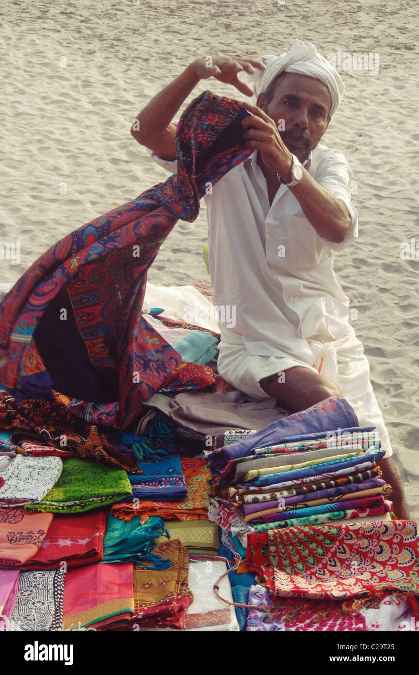 cloths selling on the beach - Stock Image