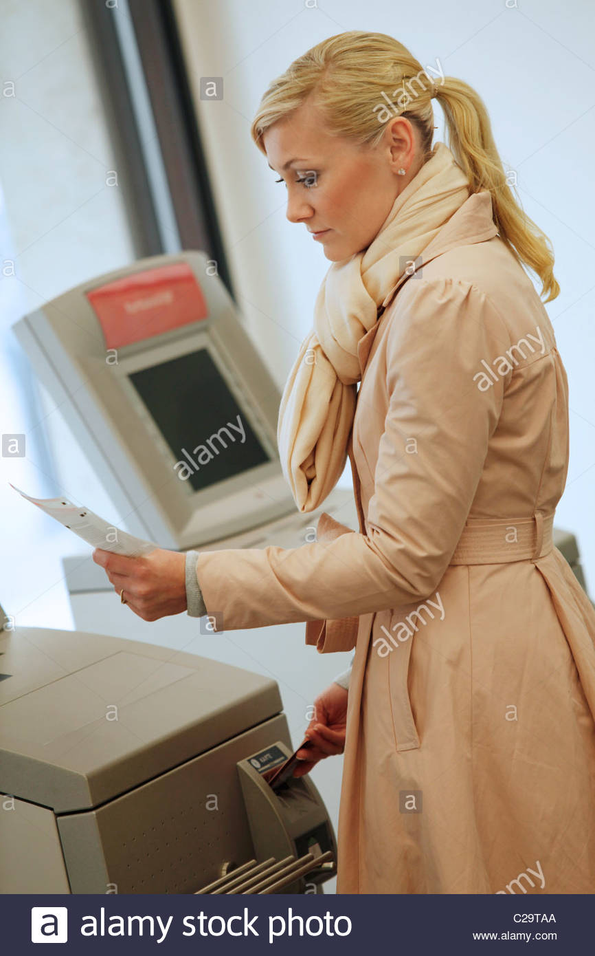 woman checking her bank account - Stock Image
