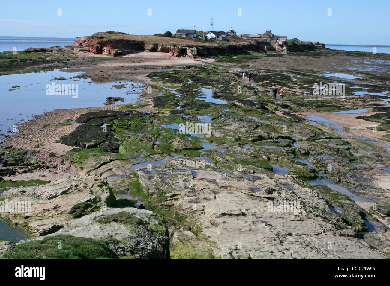 Rocky Shoreline At Low Tide, Looking Towards Hilbre Island, Wirral, UK Stock Photo