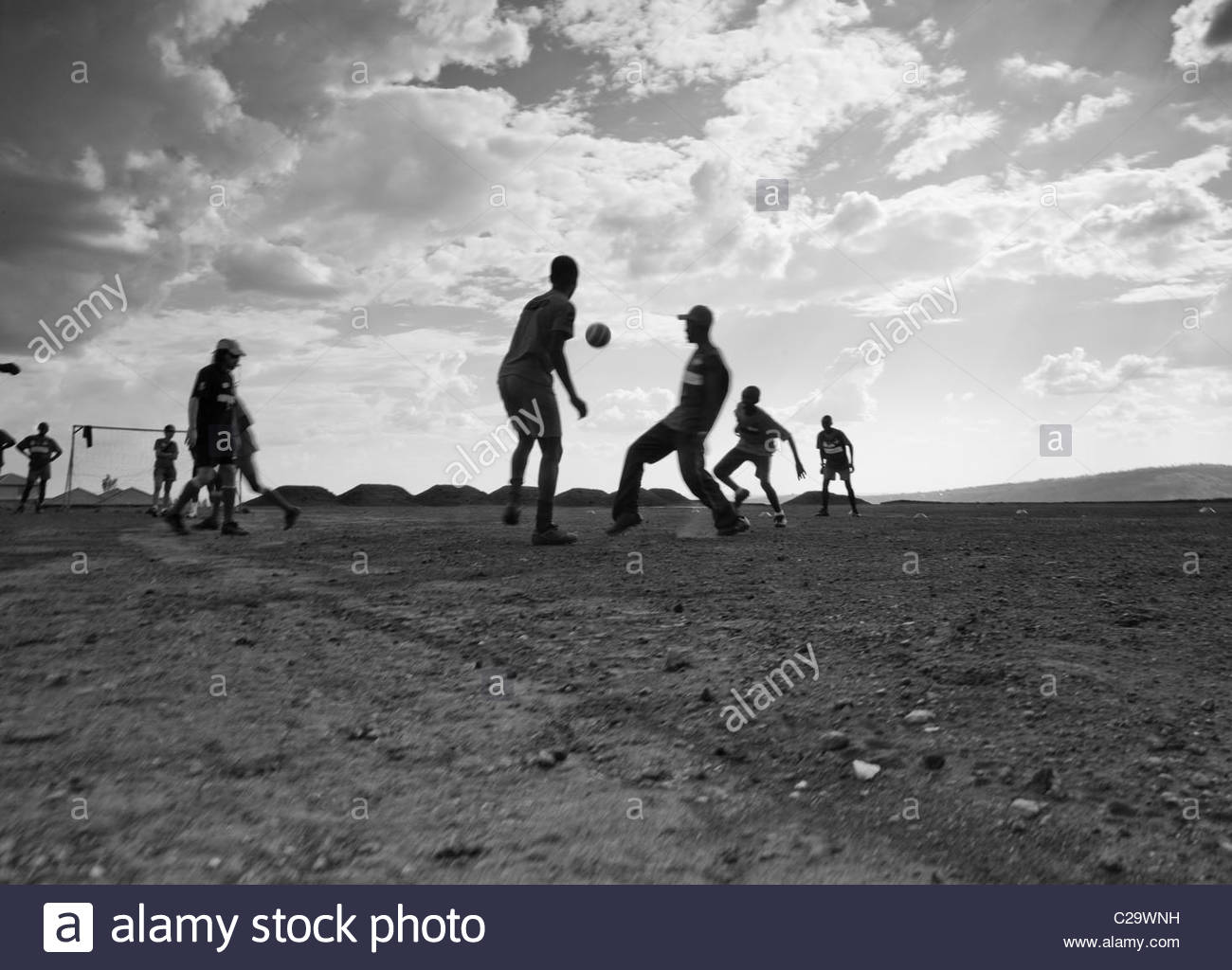 Boys play soccer at a village for survivors of the Rwandan genocide. - Stock Image