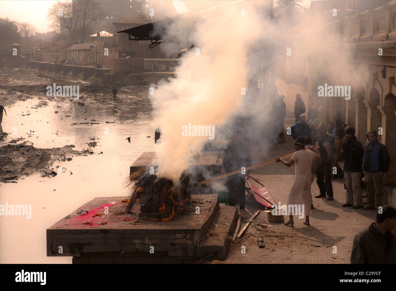 Hindu funeral rite. Burning bodies on pyre at Pashupatinath Temple. Nepal, Asia - Stock Image