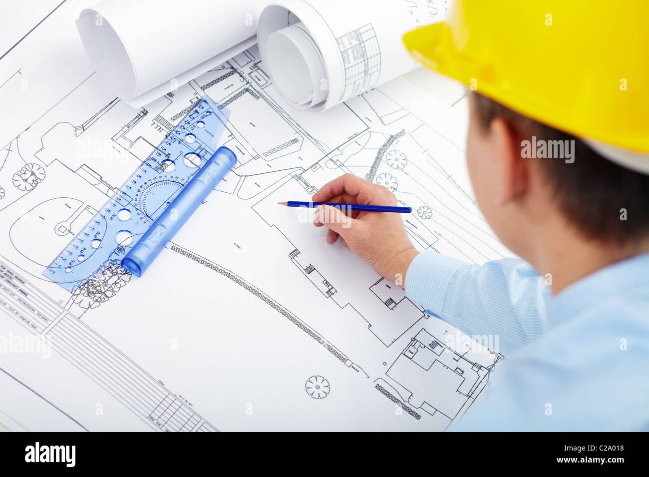 Male hand sketching housing project Stock Photo
