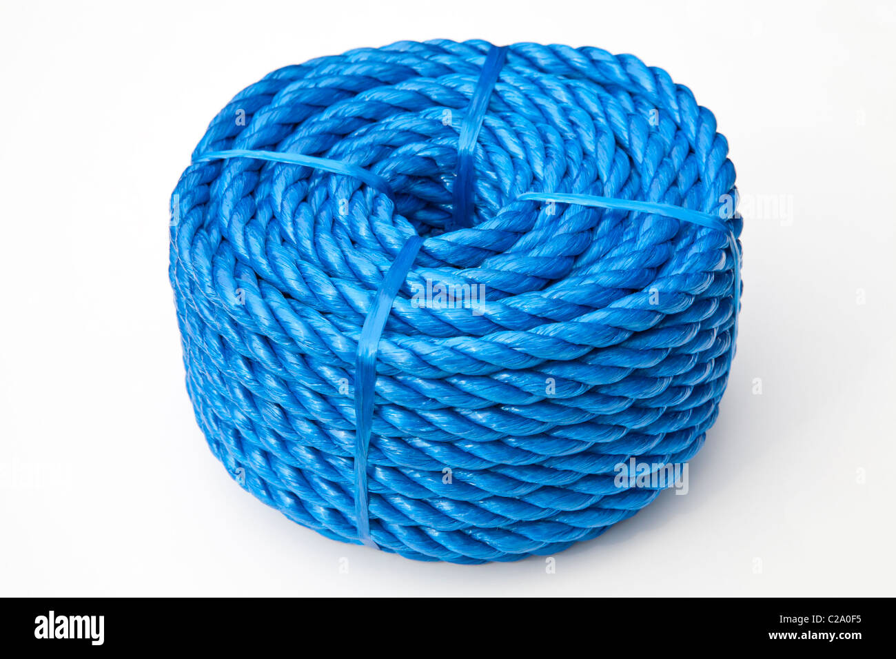 Coil of blue rope - Stock Image