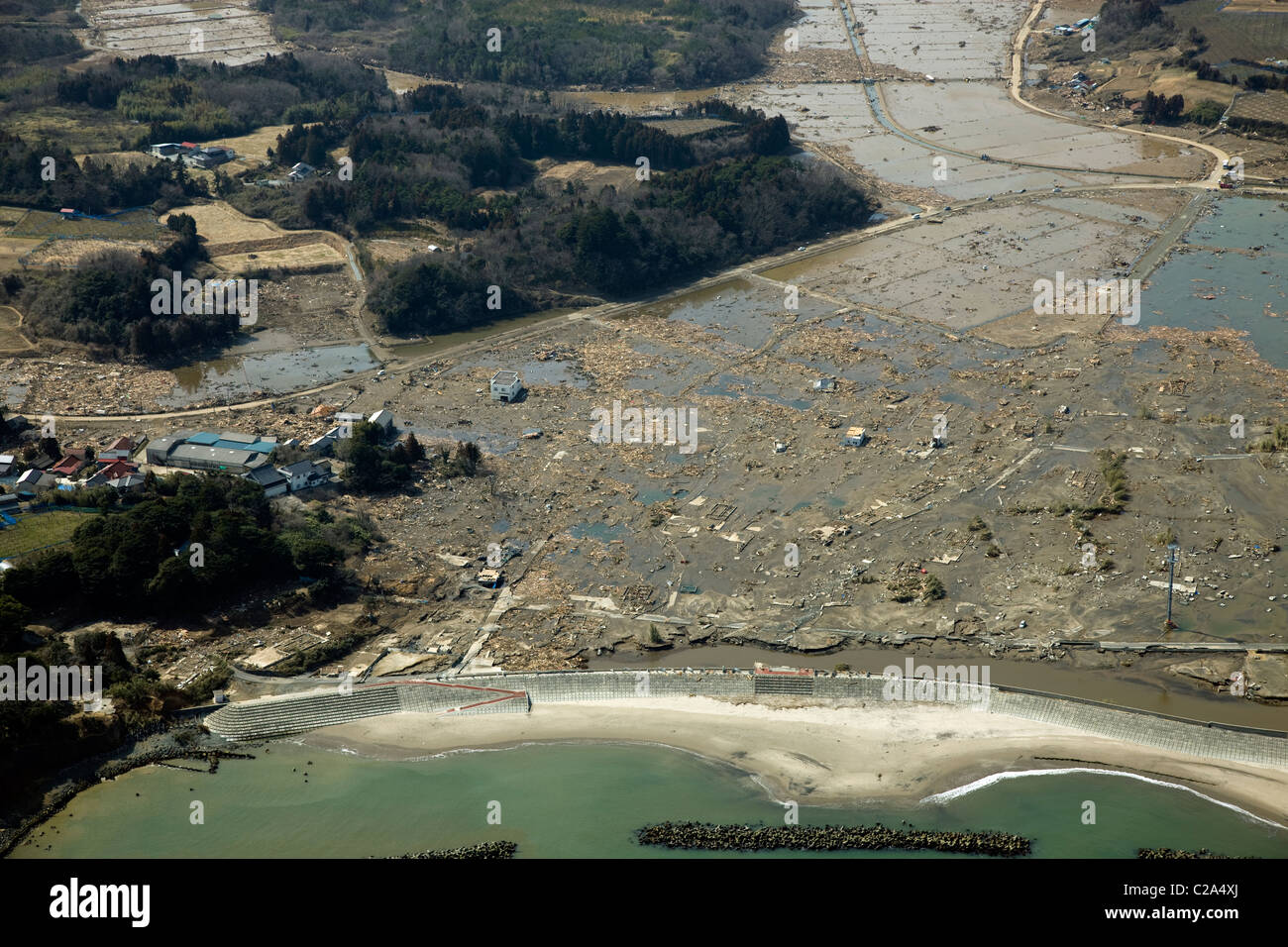 Aerial photo taken March 13 2011 of damage to Soma, Fukushima Prefecture, Japan, showing the devastation caused - Stock Image