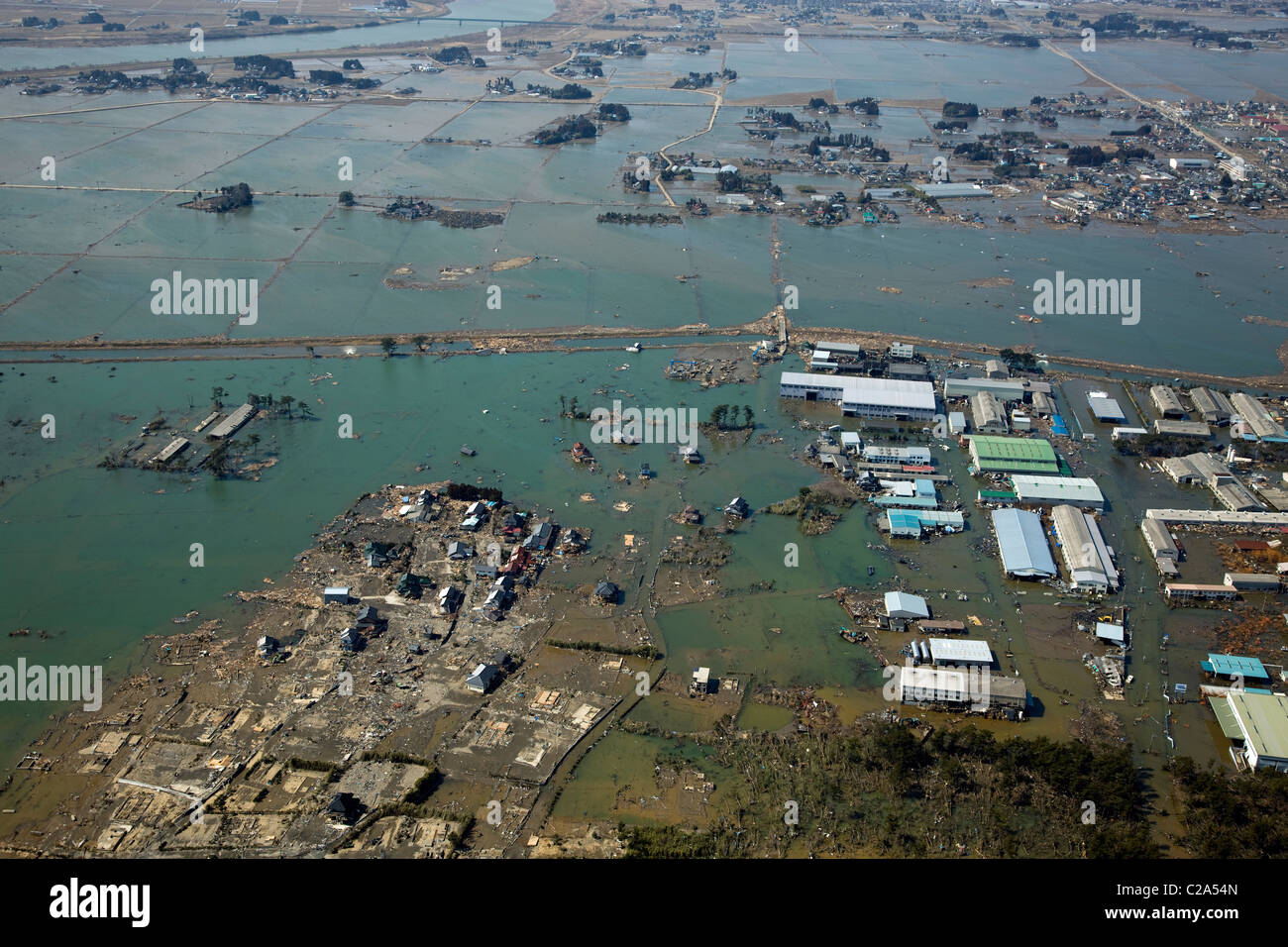 Aerial view of damage to Iwanuma, Miyagi Prefecture after a 9. 0 magnitude earthquake and subsequent tsunami devastated - Stock Image