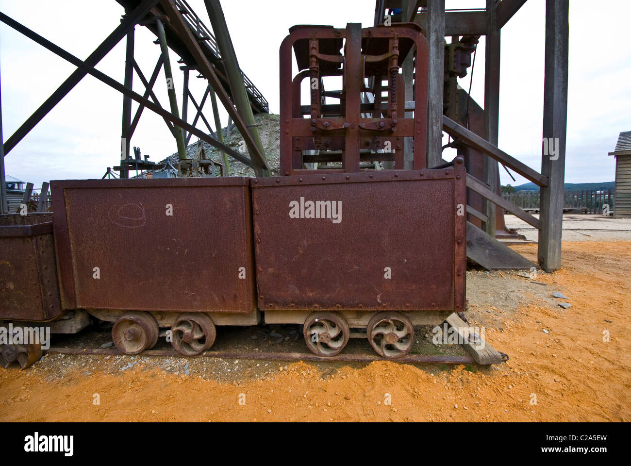 Heavy antique steel carriages used to remove ore from gold mines. - Stock Image