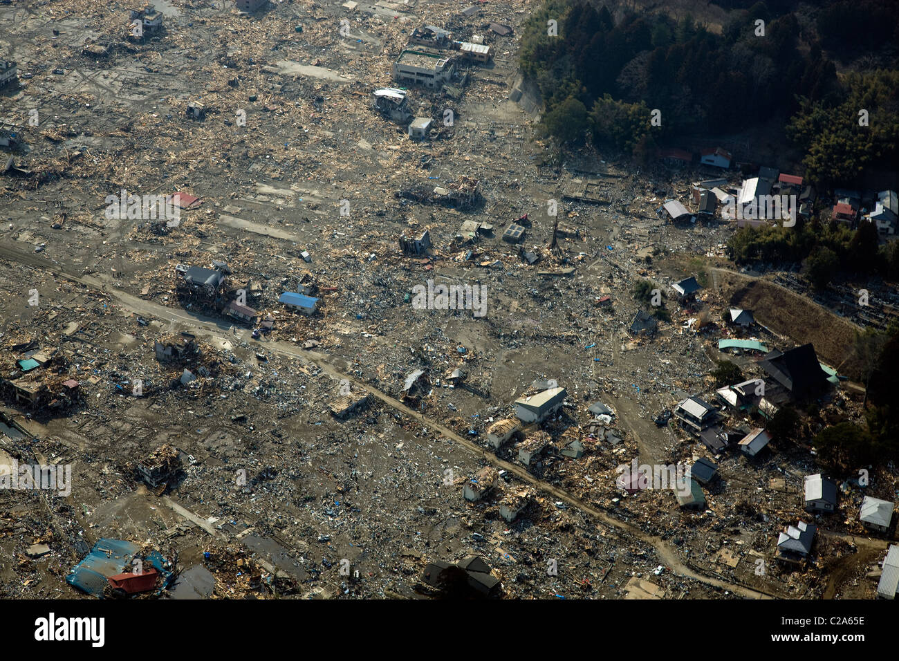 Aerial view of damage to Rikuzentakata, Iwate Prefecture after a 9. 0 magnitude earthquake and subsequent tsunami - Stock Image