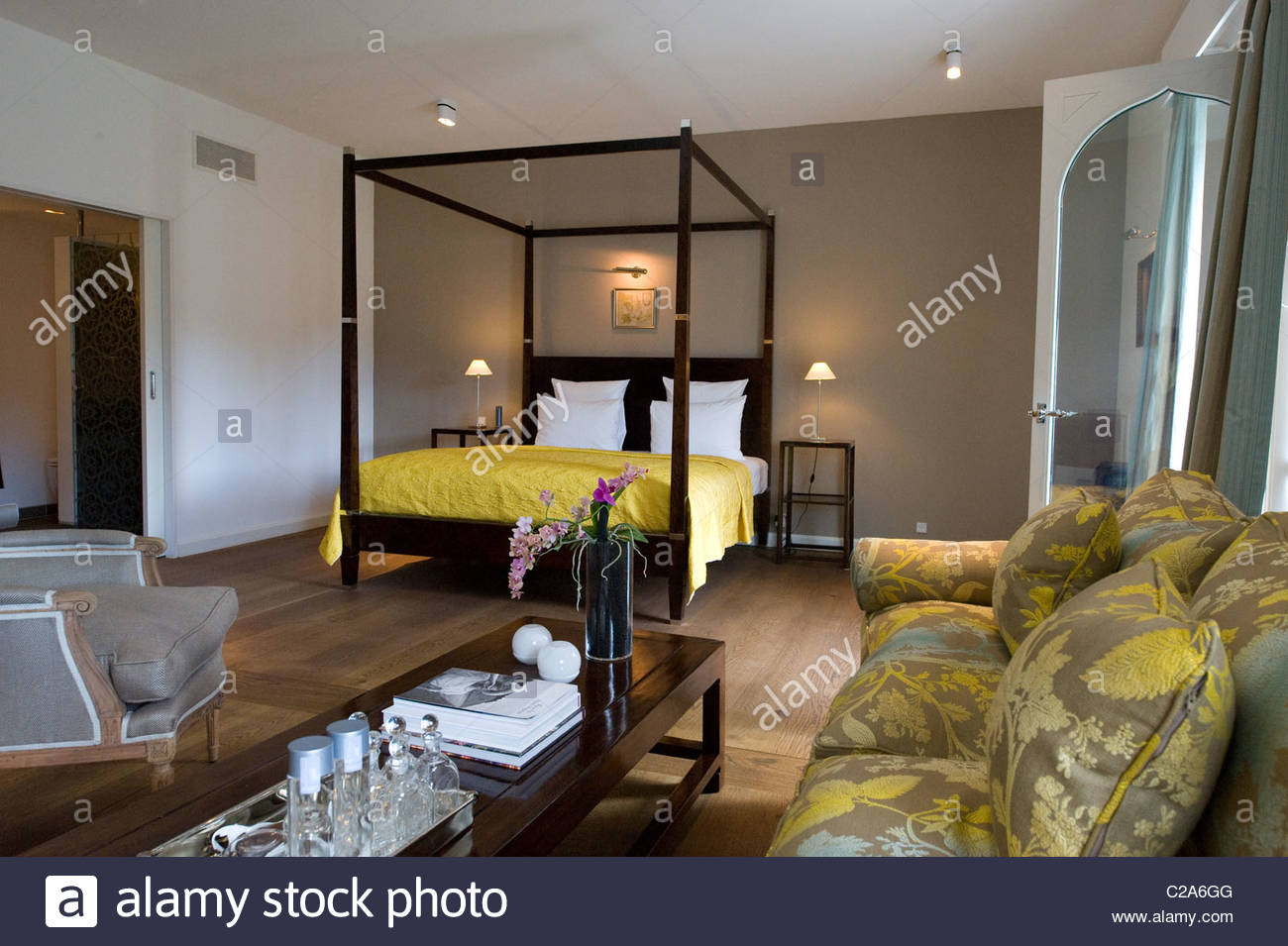 A bedroom at luxurious Hotel Nimb furnished with antiques. Stock Photo