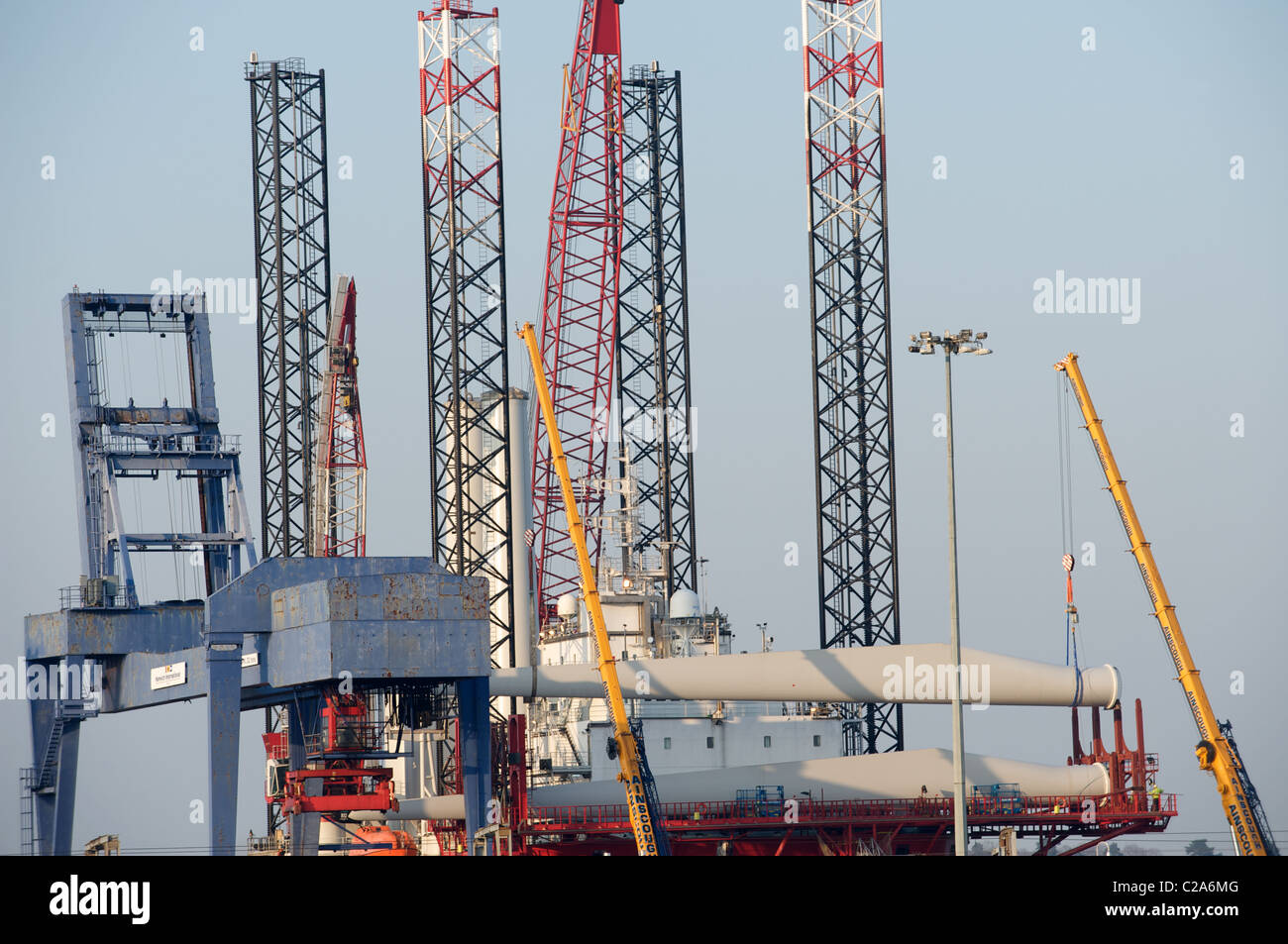 Wind turbines being loaded on to a self-propelled platform before sailing to offshore wind farm, Harwich International - Stock Image