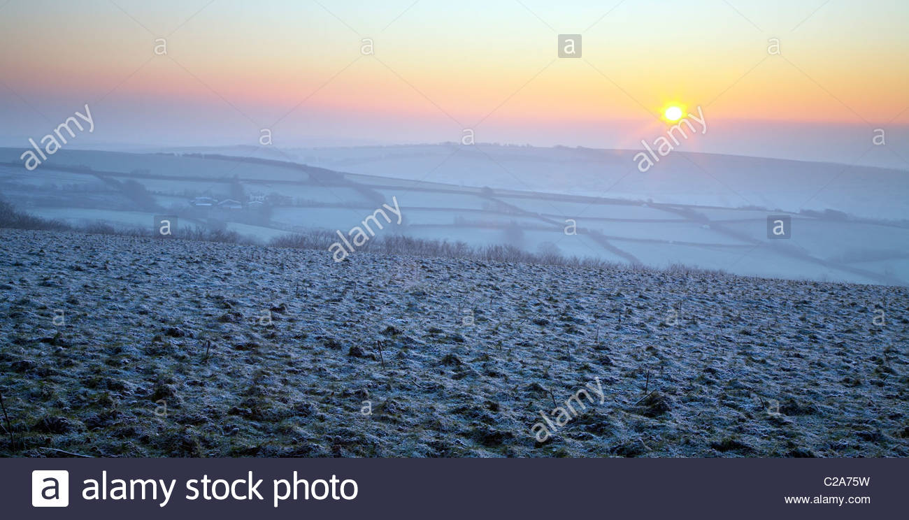 Winter sunrise over frost covered countryside, near Withypool, Exmoor National Park, Somerset, England, UK Stock Photo