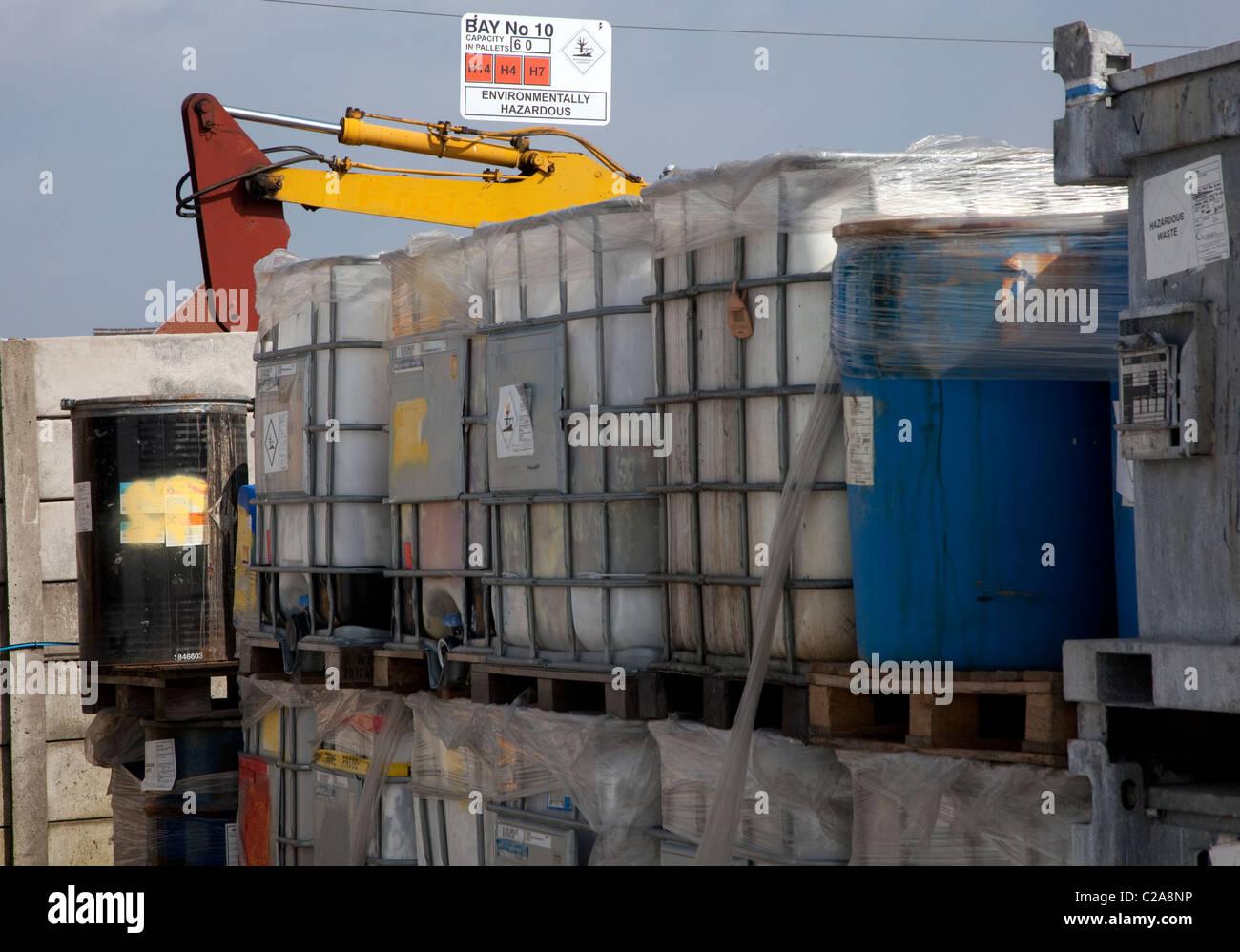Hazardous waste store on industrial treatment plant, England - Stock Image