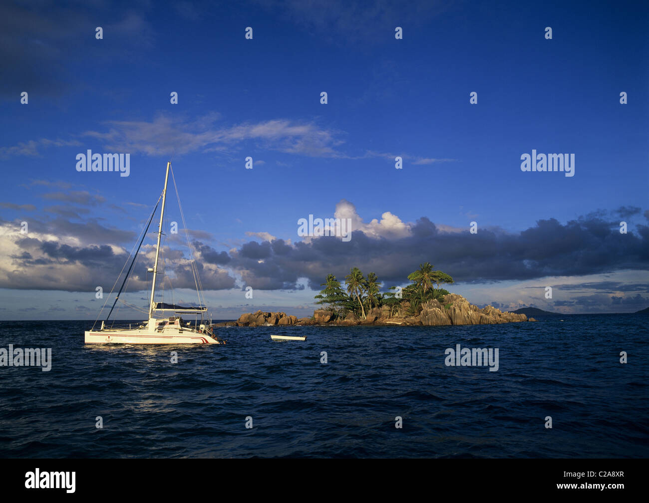 Sailing boat and dinghy at Sainte Pierre, Praslin Island, Seychelles - Stock Image