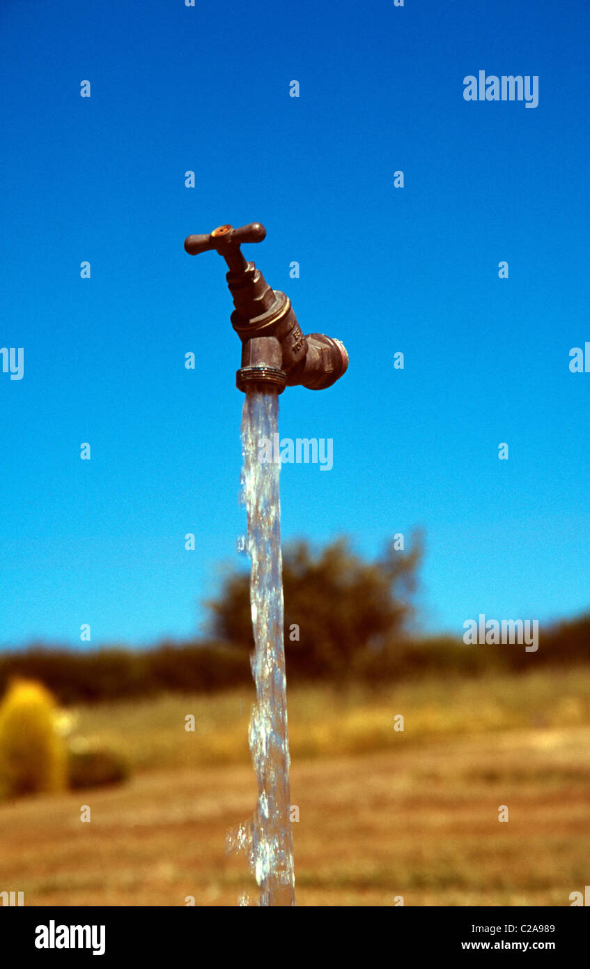 pipeless tap fountain with tapwater which appears to be an optical illusion - Stock Image