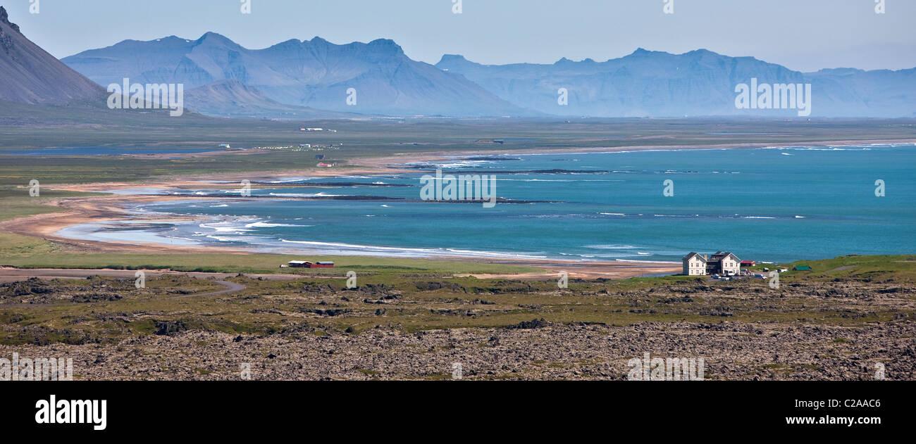 Coastline with remote Hotel Budir, Snaefellsnes Peninsula, Iceland - Stock Image