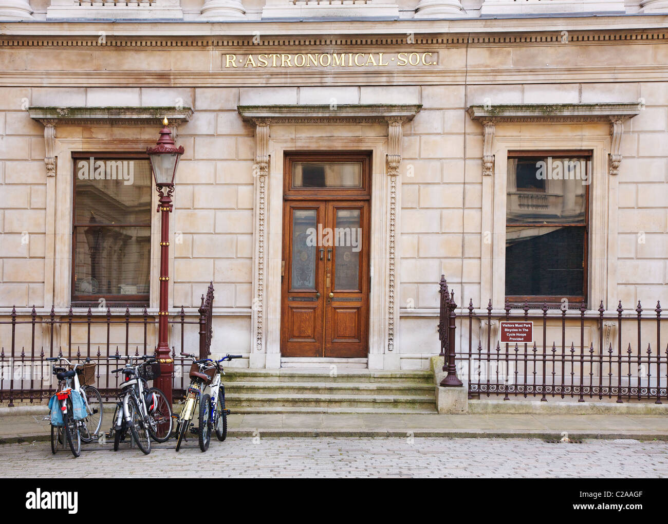 The Royal Astronomical Society building in the east wing of Burlington House in the Royal Academy courtyard in London - Stock Image