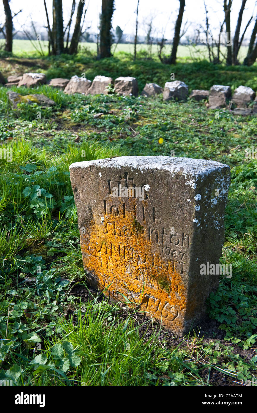 A gravestone from the 1700's in Saint Mobhi's medieval cemetery, in the countryside near Skerries, Co Dublin, - Stock Image