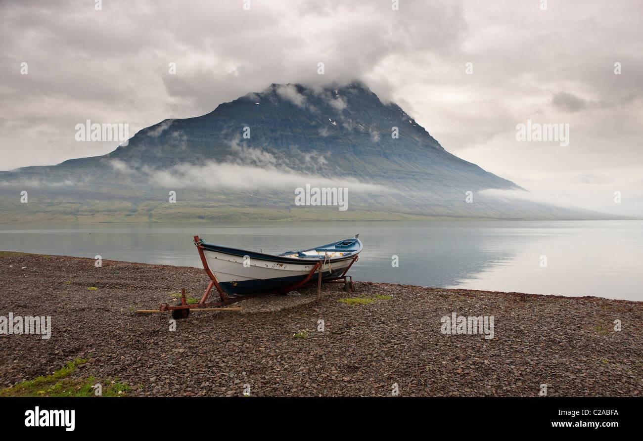 Small boat on beach, Eskifjordur, Iceland - Stock Image