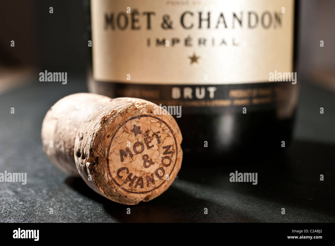 The cork and bottle of Moet and Chandon Champagne - Stock Image